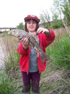 Selah with a sucker (Souris River, Manitoba, Canada)