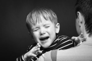 57238319 - portrait of a crying son on hands a father
